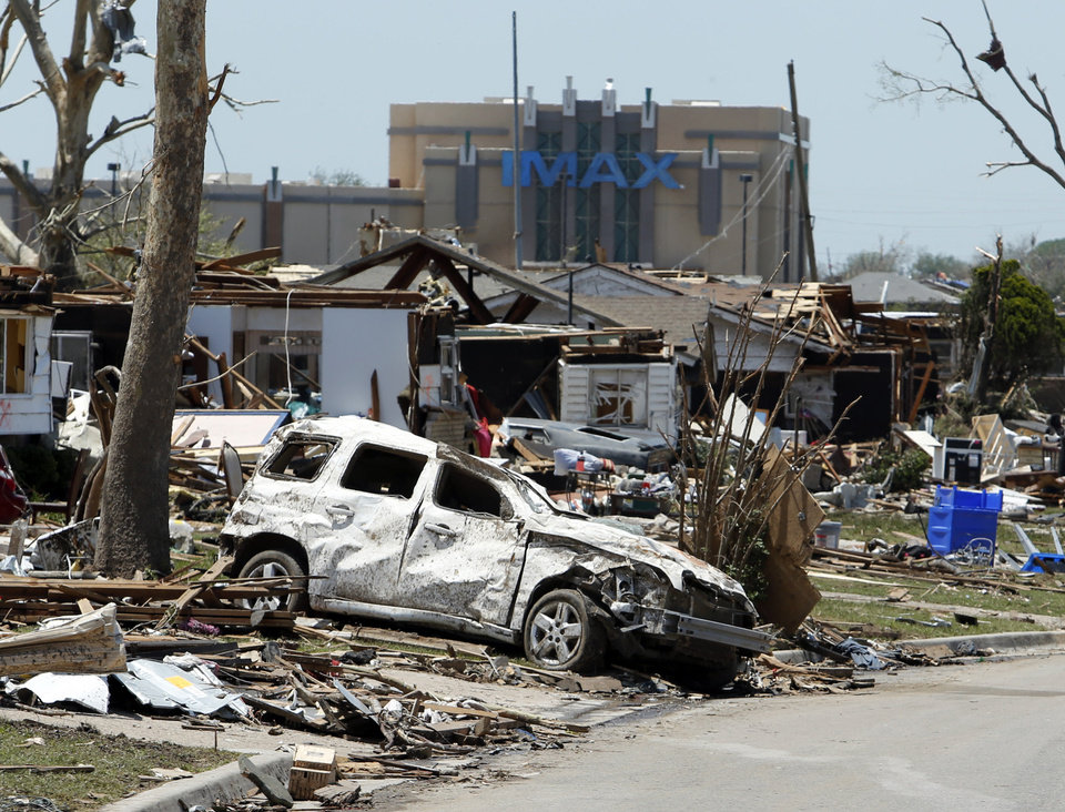 Photo - Debris is spread over yards east of Interstate 35 and accross from the Warren Theater following Monday's tornado on Wednesday, May 22, 2013 in Moore, Okla. Photo by Steve Sisney, The Oklahoman
