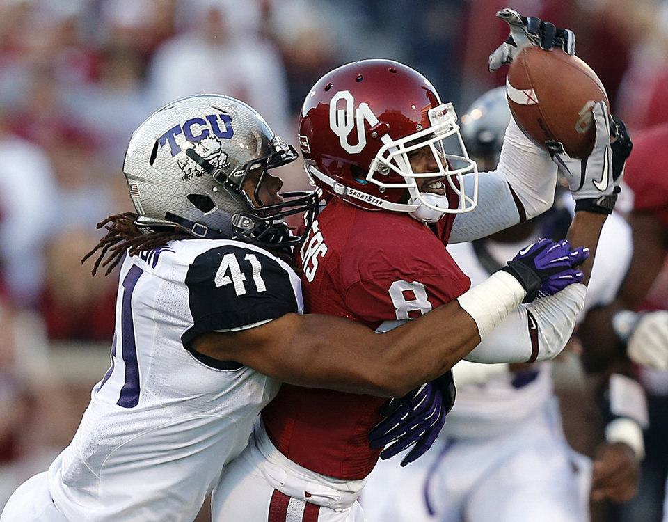 Oklahoma's Jalen Saunders (8) makes a catch in front of TCU 's Jonathan Anderson (41) during the college football game between the University of Oklahoma Sooners (OU) and the Texas Christian University Horned Frogs (TCU) at the Gaylord Family-Oklahoma Memorial Stadium on Saturday, Oct. 5, 2013 in Norman, Okla.   Photo by Chris Landsberger, The Oklahoman
