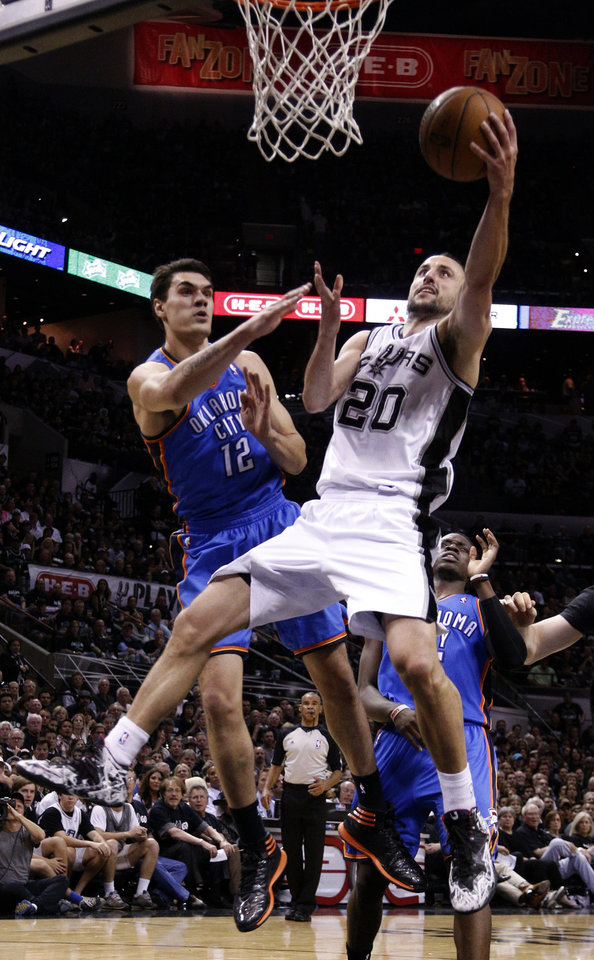 Photo - San Antonio's Manu Ginobili (20) shoots a lay up as Oklahoma City's Steven Adams (12) defends during Game 1 of the Western Conference Finals in the NBA playoffs between the Oklahoma City Thunder and the San Antonio Spurs at the AT&T Center in San Antonio, Monday, May 19, 2014. Photo by Sarah Phipps, The Oklahoman