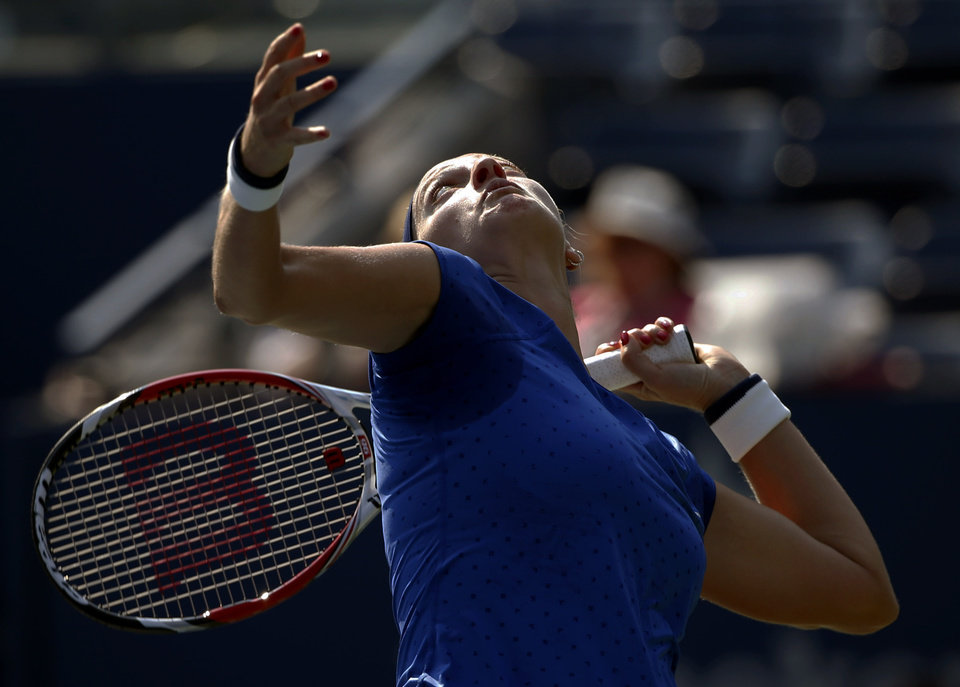 Photo - Petra Kvitova, of the Czech Republic, serves against Kristina Mladenovic, of France, during the opening round of the 2014 U.S. Open tennis tournament, Tuesday, Aug. 26, 2014, in New York. (AP Photo/Kathy Willens)