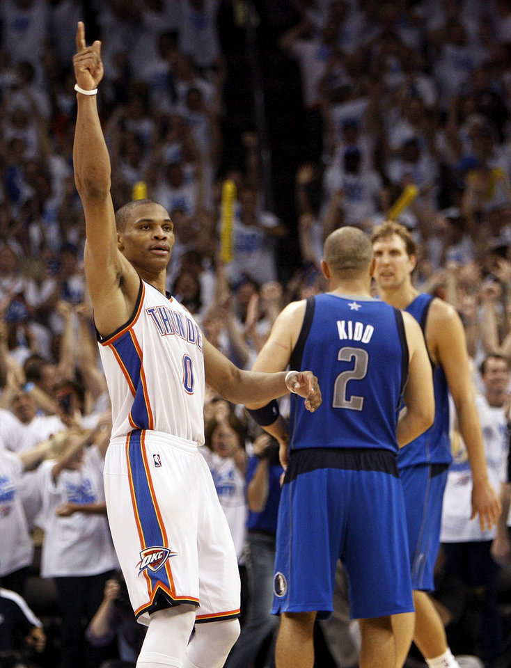 Photo - Oklahoma City's Russell Westbrook (0) reacts in front of Dallas' Jason Kidd (2) and Dirk Nowitzki (41) at the end of Game 2 of the first round in the NBA basketball  playoffs between the Oklahoma City Thunder and the Dallas Mavericks at Chesapeake Energy Arena in Oklahoma City, Monday, April 30, 2012.  Oklahoma City won, 102-99. Photo by Nate Billings, The Oklahoman