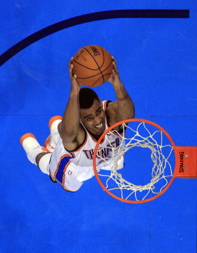 Oklahoma City's Thabo Sefolosha (2) dunks the ball during Game 1 in the first round of the NBA playoffs between the Oklahoma City Thunder and the Houston Rockets at Chesapeake Energy Arena in Oklahoma City, Monday, April 22, 2013. Photo by Sarah Phipps, The Oklahoman