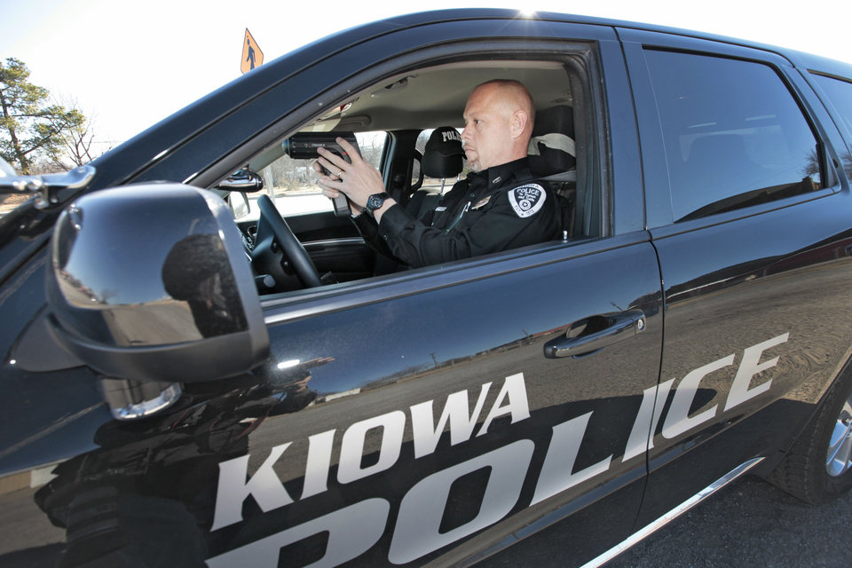 Kiowa Police Department Chief Tony Runyon checks the speed of a vehicle Friday in Kiowa on U.S. 69. Photo by David McDaniel, The Oklahoman <strong>David McDaniel</strong>