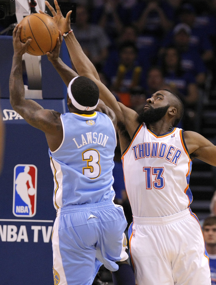 Photo - Denver's Ty Lawson (3) drives past Oklahoma City's James Harden (13) during the first round NBA playoff game between the Oklahoma City Thunder and the Denver Nuggets on Sunday, April 17, 2011, in Oklahoma City, Okla. Photo by Chris Landsberger, The Oklahoman