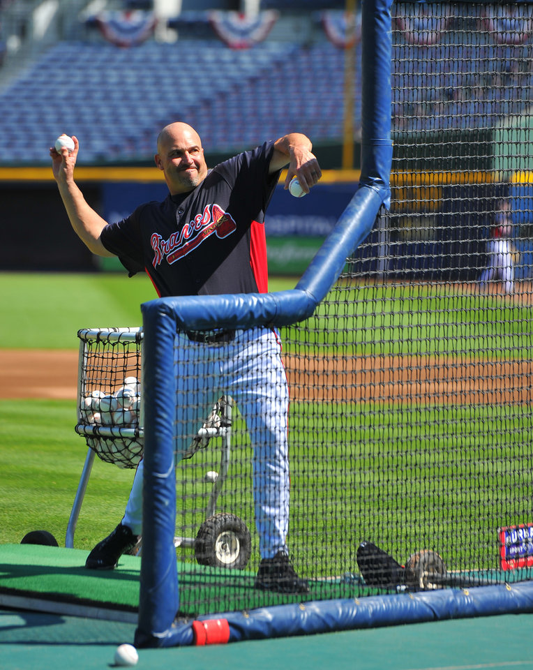 Photo -   Atlanta Braves manager Fredi Gonzalez throws batting practice at Turner Field Thursday, Oct. 4, 2012, in Atlanta. The Braves take on St. Louis Cardinals in the NL wild-card baseball game on Friday. (AP Photo/Atlanta Journal-Constitution, Brant Sanderlin) MARIETTA DAILY OUT; GWINNETT DAILY POST OUT; LOCAL TV OUT; WXIA-TV OUT; WGCL-TV OUT