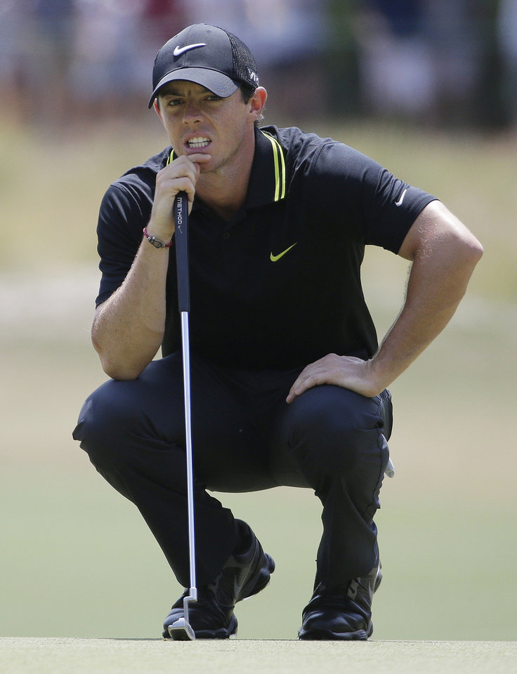 Photo - Rory McIlroy, of Northern Ireland, lines up a putt on the second hole during the third round of the U.S. Open golf tournament in Pinehurst, N.C., Saturday, June 14, 2014. (AP Photo/David Goldman)