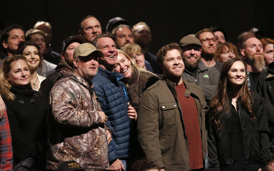 Photo -  The cast and crew take a group photo on Jan. 12 on the set of