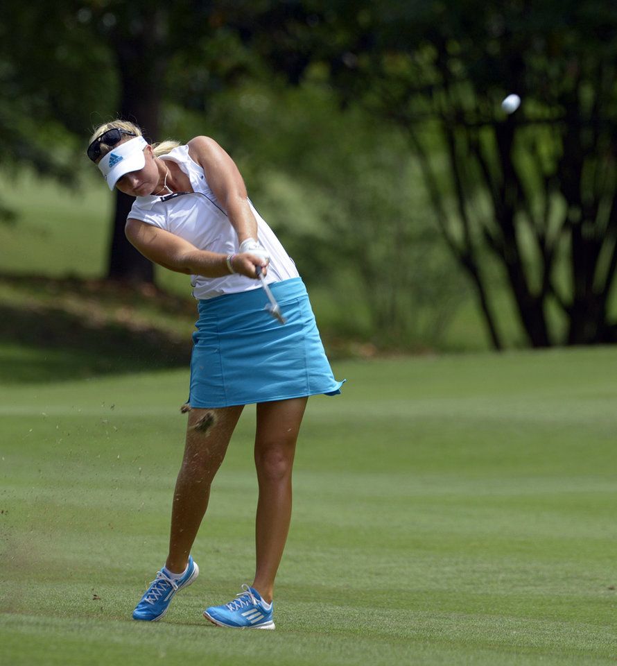 Photo - Anna Nordqvist, of Sweden, hits her second shot from the eighth fairway during the third round of the Airbus LPGA Classic golf tournament at Magnolia Grove on Saturday, May 24, 2014, in Mobile, Ala. (AP Photo/G.M. Andrews)