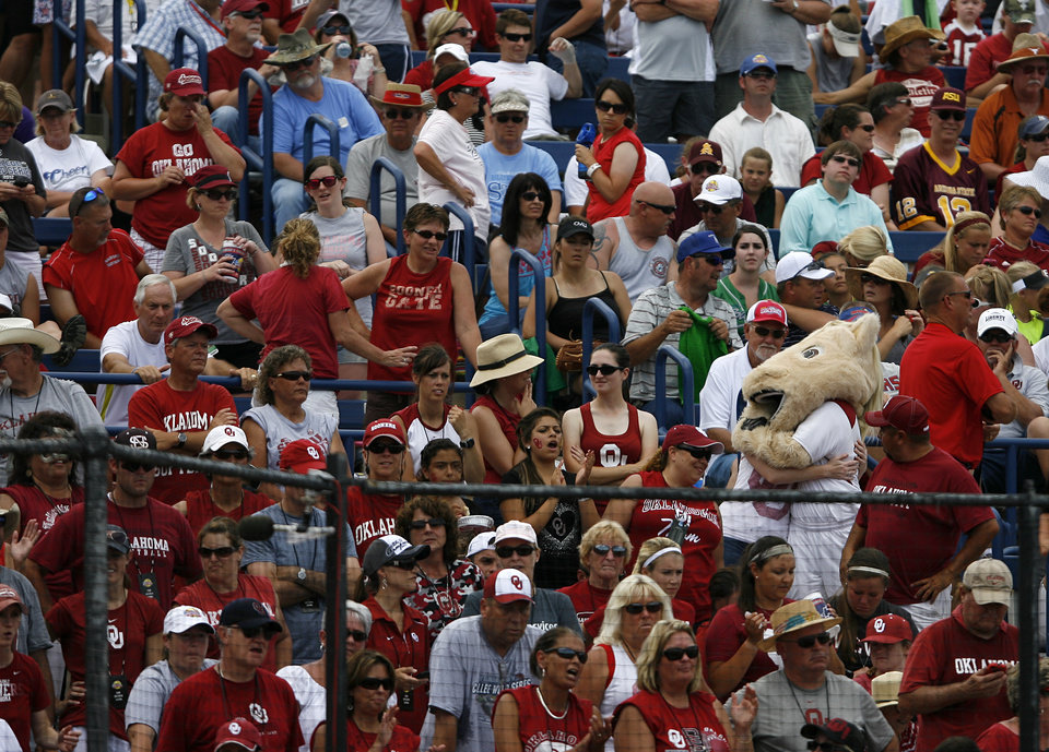 OU mascot, Sooner, hugs a fan during a Women's College World Series game between Oklahoma University and Arizona State University at ASA Hall of Fame Stadium in Oklahoma City, Sunday, June 3, 2012.  Photo by Garett Fisbeck, The Oklahoman