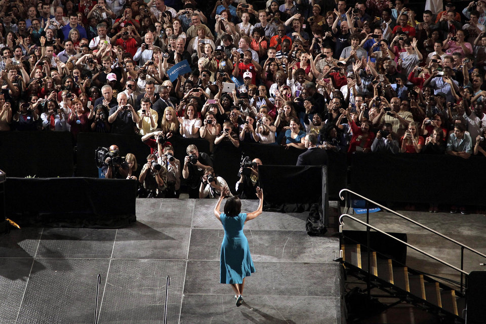 Photo -   First lady Michelle Obama takes the stage to introduce President Barack Obama during a campaign rally at The Ohio State University in Columbus, Ohio, Saturday, May 5, 2012. (AP Photo/Jae C. Hong)