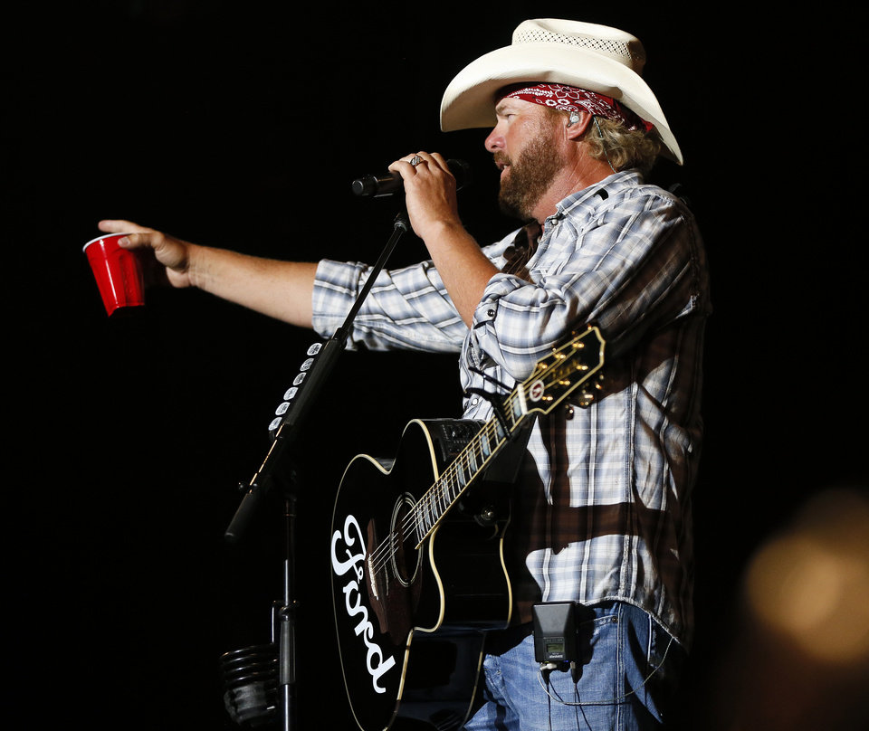 Toby Keith speaks to the crowd during the Oklahoma Twister Relief Concert, benefiting victims of the May tornadoes, at Gaylord Family - Oklahoma Memorial Stadium on the campus of the University of Oklahoma in Norman, Okla., Saturday, July 6, 2013. Photo by Nate Billings, The Oklahoman