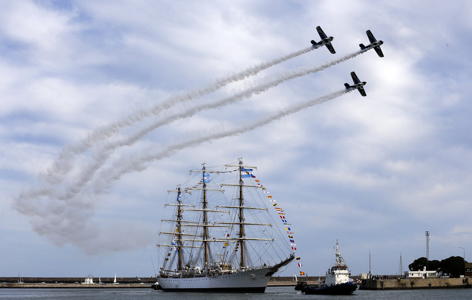"Photo - FILE - In this Jan. 9, 2013 file photo, Argentina's naval training tall ship ARA Libertad arrives to port as planes fly overhead during a ceremony in Mar del Plata, Argentina Ghana courts ordered the ship held in October on a claim by Cayman Islands-based hedge fund NML Capital Ltd. But the U.N.'s International Tribunal for the Law of the Sea ordered the ship's release after Argentina argued that warships are immune from seizure. Judgment day is approaching in an epic battle between Argentina and New York billionaire Paul Singer, who has sent lawyers around the globe trying to force the South American country to pay its defaulted debts. Three U.S. appellate judges will hear oral arguments in New York on Wednesday, Feb. 27, 2013, in the case, NML Capital Ltd. v. Argentina. The case has shaken bond markets, worried bankers, lawyers and diplomats, captivated financial analysts and generated enough ""friend of the court"" briefs to kill a small forest. (AP Photo/Natacha Pisarenko, File)"