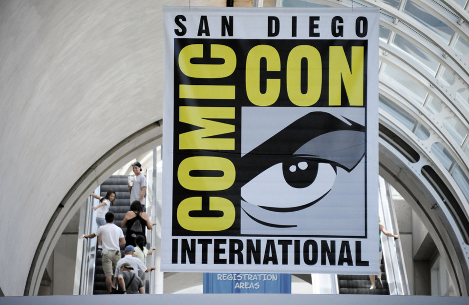 Fans arrive during Preview Night at the Comic-Con 2011 convention Wednesday, July 20, 2011 in San Diego. (AP Photo/Denis Poroy) ORG XMIT: CADP113