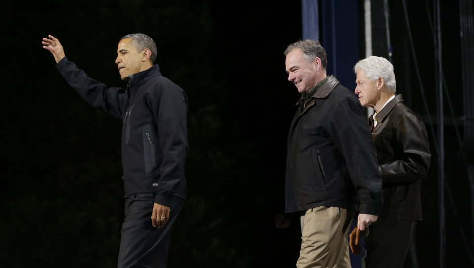 President Barack Obama, left, is joined by former President Bill Clinton, right, and Democratic candidate for the U.S. Senate from Virginia, former Gov. Tim Kaine, center, on stage at a rally at Jiffy Lube Live arena, late Saturday night, Nov. 3, 2012, in Bristow, Va. (AP Photo/Pablo Martinez Monsivais)