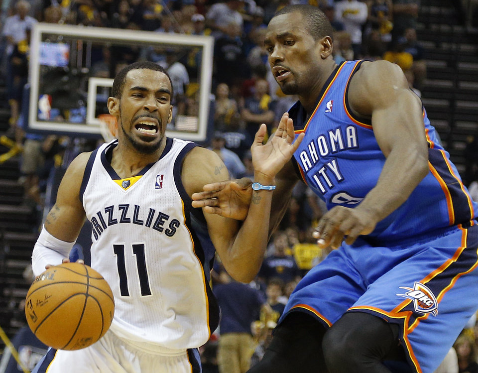 Photo - Oklahoma City's Serge Ibaka (9) defends Memphis' Mike Conley (11) during Game 4 in the first round of the NBA playoffs between the Oklahoma City Thunder and the Memphis Grizzlies at FedExForum in Memphis, Tenn., Saturday, April 26, 2014. Photo by Bryan Terry, The Oklahoman