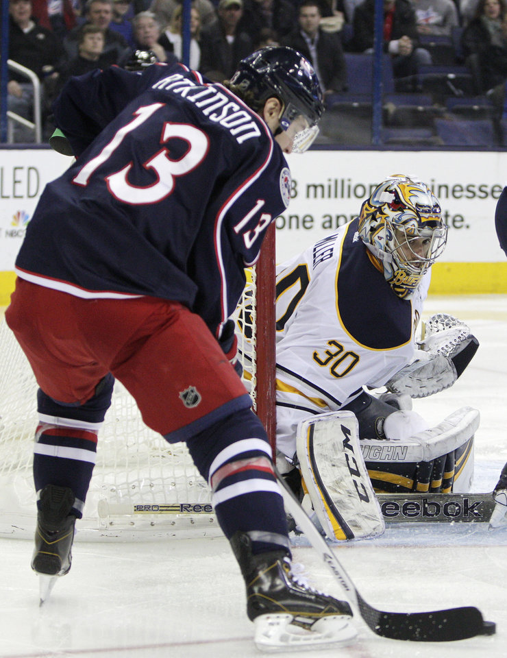 Photo - Buffalo Sabres' Ryan Miller, right, makes a save against Columbus Blue Jackets' Cam Atkinson during the second period of an NHL hockey game, Saturday, Jan. 25, 2014, in Columbus, Ohio. The Sabres won 5-2. (AP Photo/Jay LaPrete)