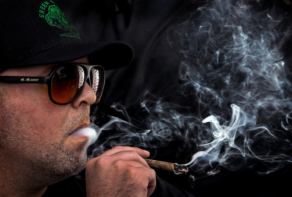 Photo - Barry Magnin smokes marijuana from the Green Buffalo located at 784 Asp Ave. in Norman, Okla. on Thursday, Aug. 1, 2019. The Green Buffalo is a newer dispensary on Campus Corner in Norman, despite colleges around the state still banning even medical marijuana, owner Joe Wilson thinks he has the best location in the state. [Chris Landsberger/The Oklahoman]