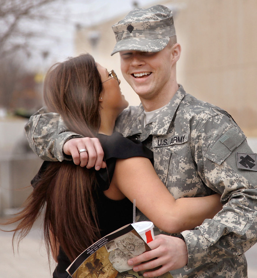 MILITARY DEPLOYMENT: SPC Josh Green of Moore, OK, gets a hug from his girlfriend, Sydney Schaer  (c q) as she arrives to attend the 45th Infantry Brigade Combat Team deployment ceremony inside the Cox Convention Center,  Wednesday, Feb. 16, 2011.  Photo by Jim Beckel, The Oklahoman