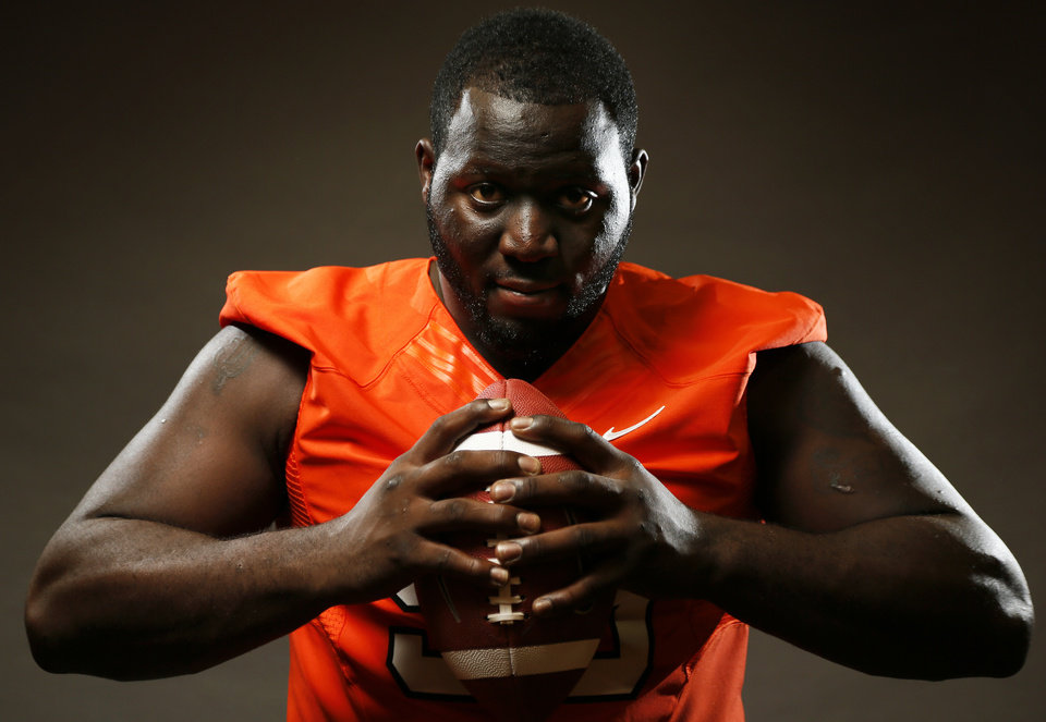 Photo - COLLEGE FOOTBALL: Calvin Barnett (99) poses for a photo during media day for the Oklahoma State University football team inside OSU's Gallagher-Iba Arena, Saturday, Aug. 3, 2013. Photo by Nate Billings, The Oklahoman
