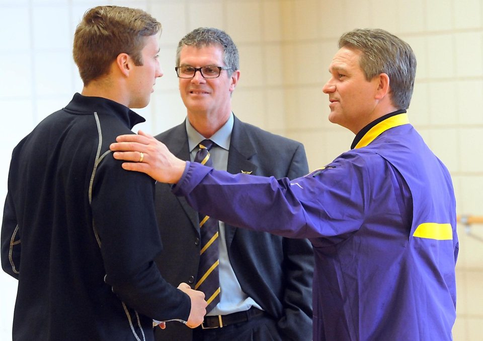 Photo - Minnesota State, Mankato football coach Todd Hoffner, right, and athletic director Kevin Buisman talk with defensive back Samuel Thompson after a news conference Thursday, April 17, 2014, in Mankato, Minn. players ended their boycott of spring practice and said Thursday they will play for coach Todd Hoffner, who was reinstated after being exonerated of having child pornography on his cellphone. (AP Photo/Mankato Free Press, Pat Christman)