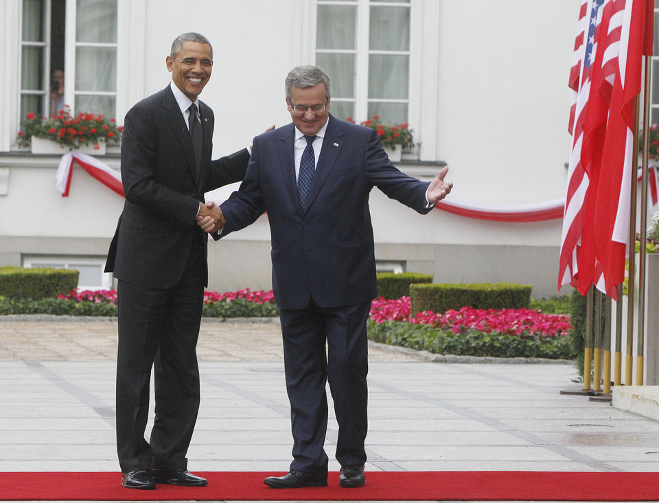 Photo - Polish President Bronislaw Komorowski welcomes US President Barack Obama,left,at his Belweder residence in Warsaw, Poland, on Tuesday June 3, 2014. Obama came to Poland to meet regional leaders and attend ceremonies marking 25 years of Poland's democracy.(AP Photo/Czarek Sokolowski)