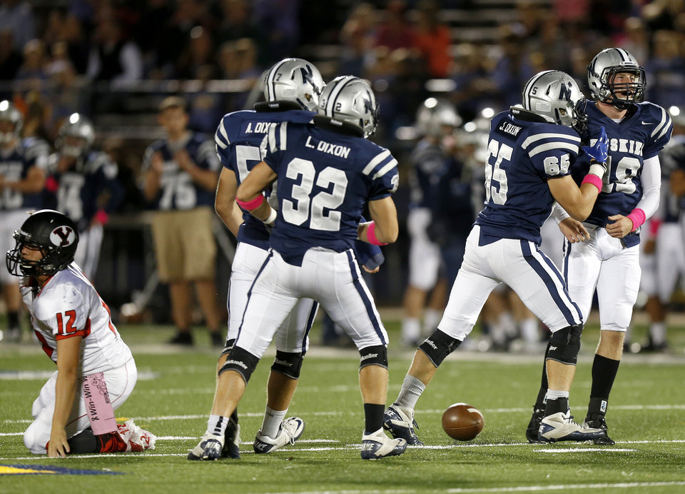 Photo - Edmond North's Sam Delzell, right, and Joel Dixon celebrate after Yukon's Hayden Somerville, left, was sacked during a high school football game at Wantland Stadium in Edmond, Okla., Thursday, October 4, 2012. Photo by Bryan Terry, The Oklahoman
