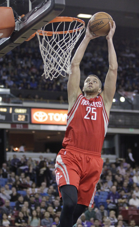 Photo - Houston Rockets forward Chandler Parsons goes up for a shot against the Sacramento Kings during the first quarter of an NBA basketball game in Sacramento, Calif., Tuesday Feb. 25, 2014. (AP Photo/Rich Pedroncelli)