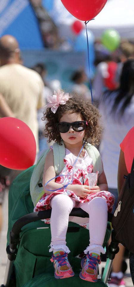 Photo - Jane Foley, 3, rests on the top of the stroller at Open Streets OKC, along NW 23rd Street between Robinson and Western, Sunday, March 22, 2015. Photo by Doug Hoke, The Oklahoman