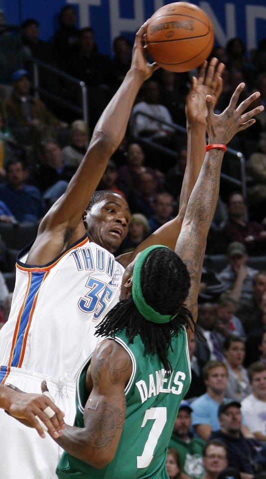 Photo - Kevin Durant (35) of Oklahoma City passes the ball over Marquis Daniels (7) of Boston in the second half of the NBA basketball game between the Boston Celtics and the Oklahoma City Thunder at the Ford Center in Oklahoma City, Friday, Dec. 4, 2009. The Thunder turned the ball over on the play. Boston won, 105-87. Photo by Nate Billings, The Oklahoman ORG XMIT: KOD