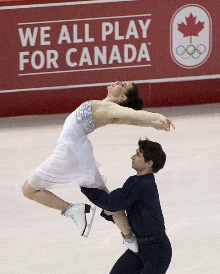 Photo - Tessa Virtue, top, and Scott Moir perform during the short dance practice session at the Canadian Figure Skating Championships, Thursday, Jan. 9, 2014, in Ottawa, Ontario. (AP Photo/The Canadian Press, Adrian Wyld)