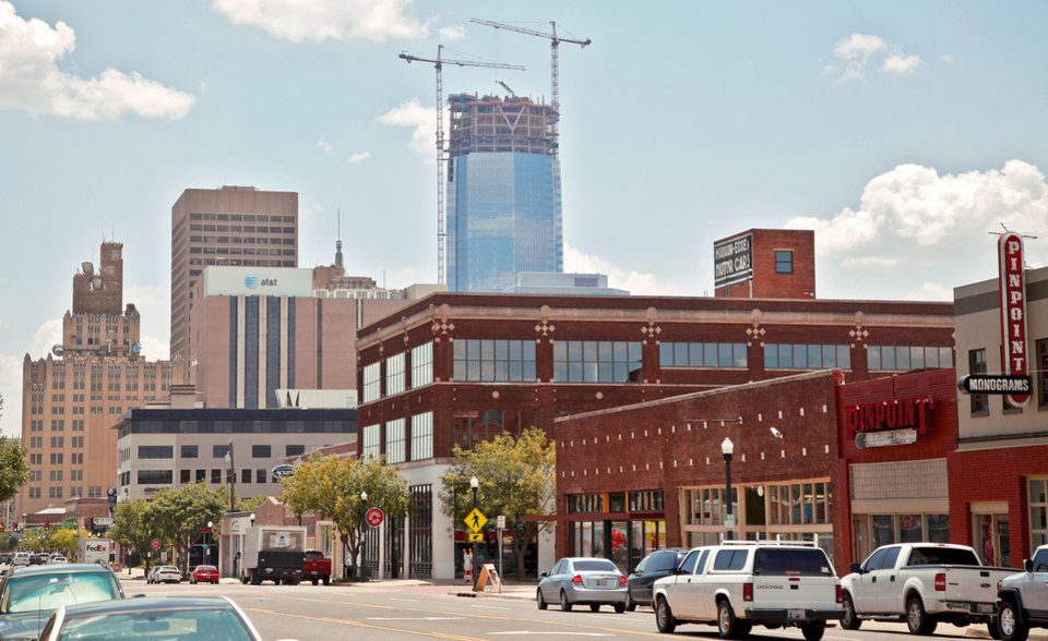 Photo - Downtown's skyline rises above Automobile Alley in Oklahoma City.  PHOTO BY CHRIS LANDSBERGER,  THE OKLAHOMAN ARCHIVE