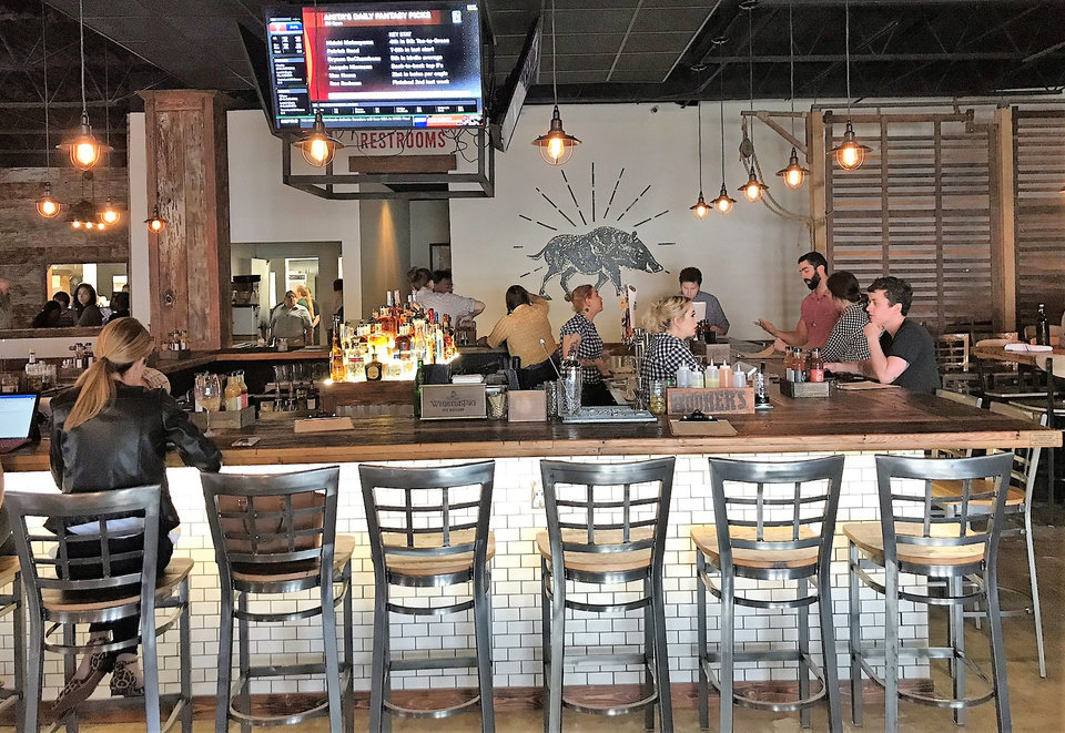 Photo - The Smoking Boar features a large bar and cocktail program. [Dave Cathey/The Oklahoman]