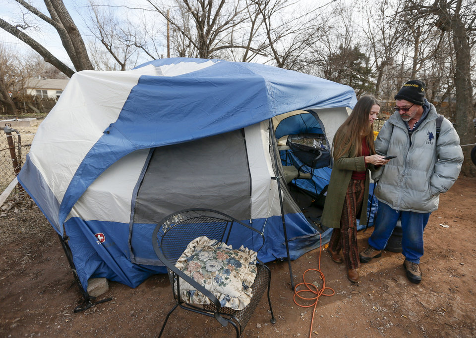 Photo - Jamie Zumwalt, 51, founder and pastor of Joe's Addiction, left, talks to Luther, 52, who preferred not to give his last name, as lunch was being served out of a tent at 6100 S Cox, near the original location of Joe's Addiction, in Valley Brook, Okla., Monday, Dec. 23, 2019. While the new site for Joe's Addiction is not ready, Zumwalt continues to help the community of people in need who were being served by Joe's Addiction. [Nate Billings/The Oklahoman]