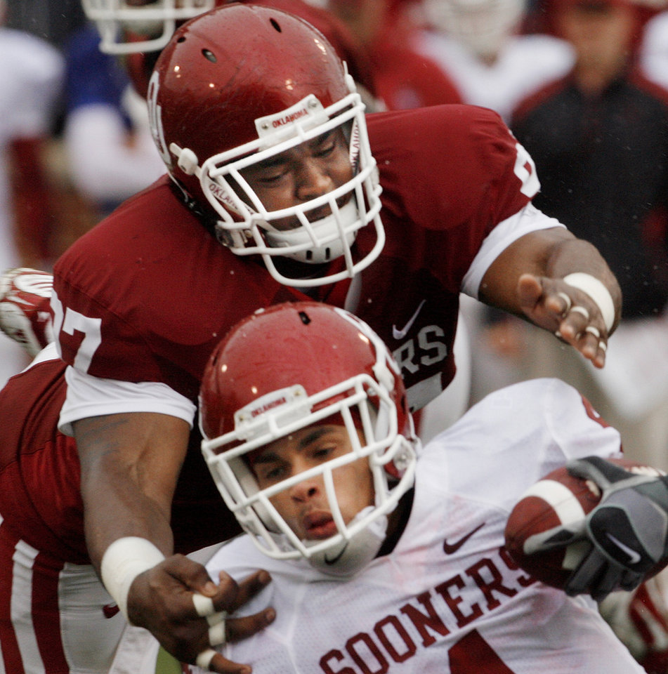 Photo - COLLEGE FOOTBALL / RED AND WHITE SPRING GAME: Jamarkus McFarland (97) brings down Kenny Stills during the spring Red and White football game for the University of Oklahoma (OU) Sooners at Gaylord Family -- Oklahoma Memorial Stadium on Saturday, April 17, 2010, in Norman, Okla.  Photo by Steve Sisney, The Oklahoman ORG XMIT: KOD