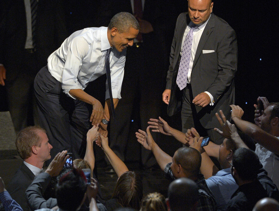 Photo -   President Barack Obama shakes hands with supporters at a campaign event at the Nokia Theater, Sunday, Oct. 7, 2012, in Los Angeles. (AP Photo/Mark J. Terrill)