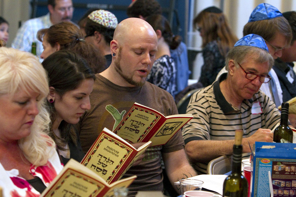 John West IV reads from the Passover Haggadah as The University of Oklahoma (OU) Hillel Foundation, an organization that provides support and activities for Jewish students, hosts a Passover Seder on the first night of Passover on Friday, April 6, 2012, in Norman, Okla.  Photo by Steve Sisney, The Oklahoman