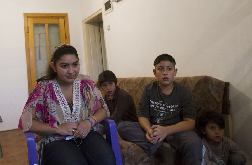 Photo - From left 15 year old Leonarda Dibrani, joined by her brothers Ronaldo 9,  Roki 11, Masar 5, expelled from France last week, during an interview for The Associated Press in a room of a shelter house in Mitrovica, northern Kosovo, Wednesday, Oct 16, 2013. France's government, trying to save face amid widespread outrage, said Wednesday that it is investigating the treatment of a 15-year-old girl of the Dibrani family who was detained by police in front of her fellow students so she and her family could be expelled to Kosovo as illegal immigrants. (AP Photo/Visar Kryeziu)