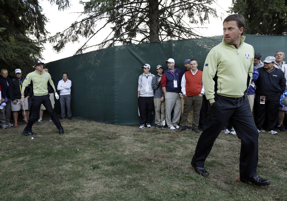 Photo -   Europe's Graeme McDowell looks over a shot by Rory McIlroy on the first hole during a foursomes match at the Ryder Cup PGA golf tournament Friday, Sept. 28, 2012, at the Medinah Country Club in Medinah, Ill. (AP Photo/David J. Phillip)