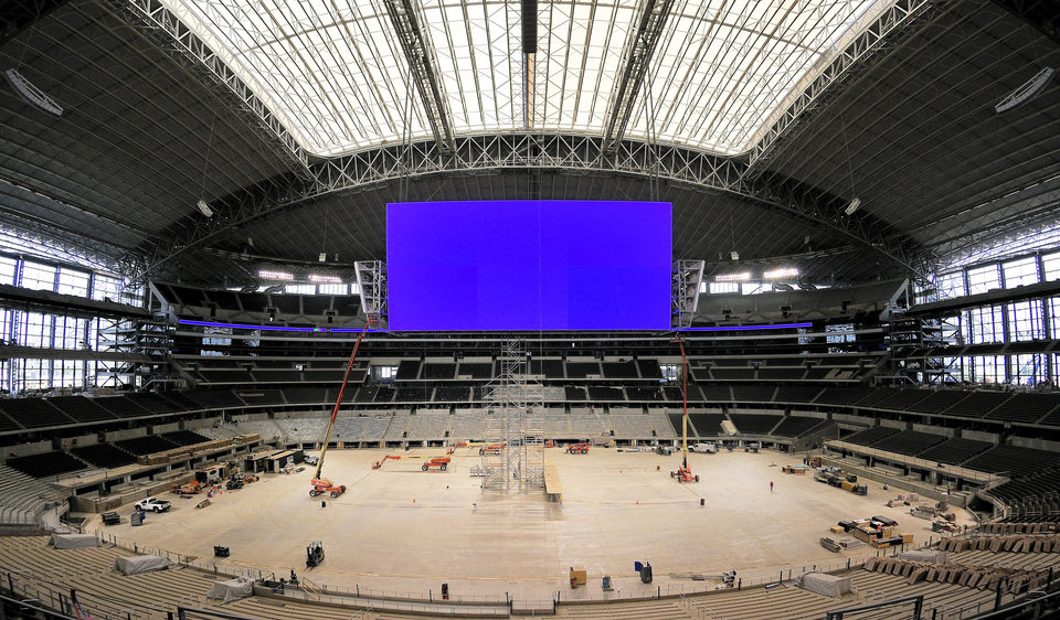 Photo - The massive scoreboard hangs from the ceiling above the field, stretching from 20-yard line to 20-yard line. Photo by Max Faulkner, Fort Worth Star-Telegram