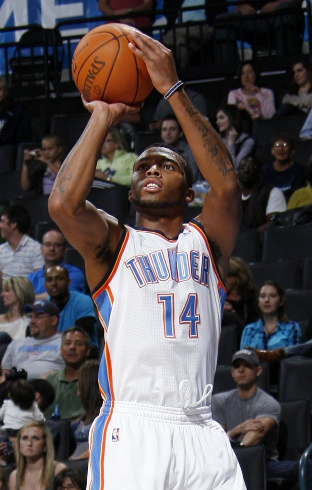 Photo - Daequan Cook (14) of Oklahoma City shoots during the preseason NBA basketball game between the New Orleans Hornets and the Oklahoma City Thunder at the Ford Center in Oklahoma City, Thursday, October 21, 2010. The Thunder won, 101-86. Photo by Nate Billings, The Oklahoman