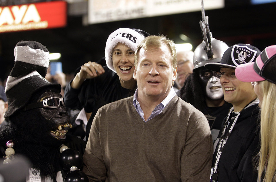 NFL Commissioner Roger Goodell is surrounded by Oakland Raiders fans in the Black Hole during the second quarter of an NFL football game against the Denver Broncos in Oakland, Calif., Thursday, Dec. 6, 2012. (AP Photo/Ben Margot)