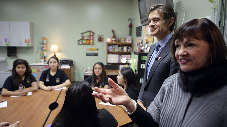 Photo - Freda Deskin, founder and principal of ASTEC Charter Schools, gives Dr. Mehmet Oz a tour of the school. ASTEC is the first school in the region to participate in HealthCorps. Photos by Garett Fisbeck, The Oklahoman