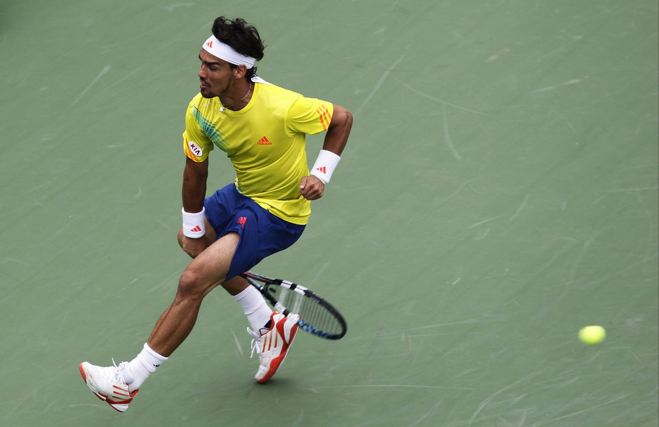 Photo -   Italy's Fabio Fognini returns a shot through his legs to Andy Roddick in the third round of play at the 2012 US Open tennis tournament, Sunday, Sept. 2, 2012, in New York. (AP Photo/Mel C. Evans)