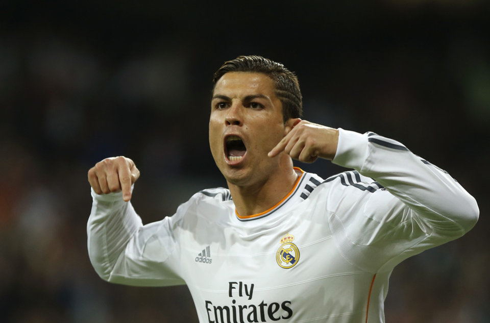 Photo - Real's Cristiano Ronaldo celebrates scoring his side's first goal during a Group B Champions League soccer match between Real Madrid and Juventus at the Santiago Bernabeu stadium in Madrid, Spain, Wednesday Oct. 23, 2013. (AP Photo/Andres Kudacki)