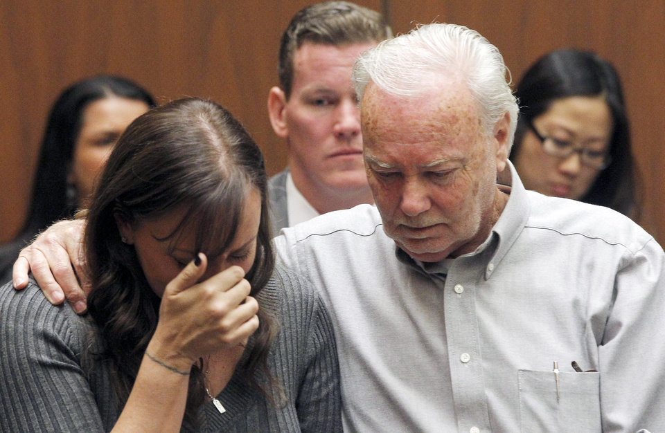 Photo - Evin Collins, and David Stow, sister and father of beating victim Bryan Stow are shown during a hearing Thursday Feb. 20, 2014 in Los Angeles. Two men, Marvin Norwood, and Louie Sanchez  pleaded guilty Thursday to a 2011 beating at Dodger Stadium that left San Francisco Giants fan Stow brain damaged and disabled. The pair were  immediately sentenced by an angry judge who called them cowards and the sort of people that sports fans fear when they go to games.(AP Photo/Nick Ut )