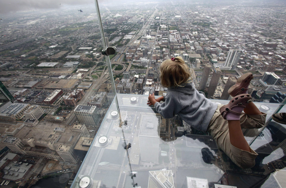 Photo - FILE - This June 24, 2009 file photo shows Anna Kane, 5, looking down from the