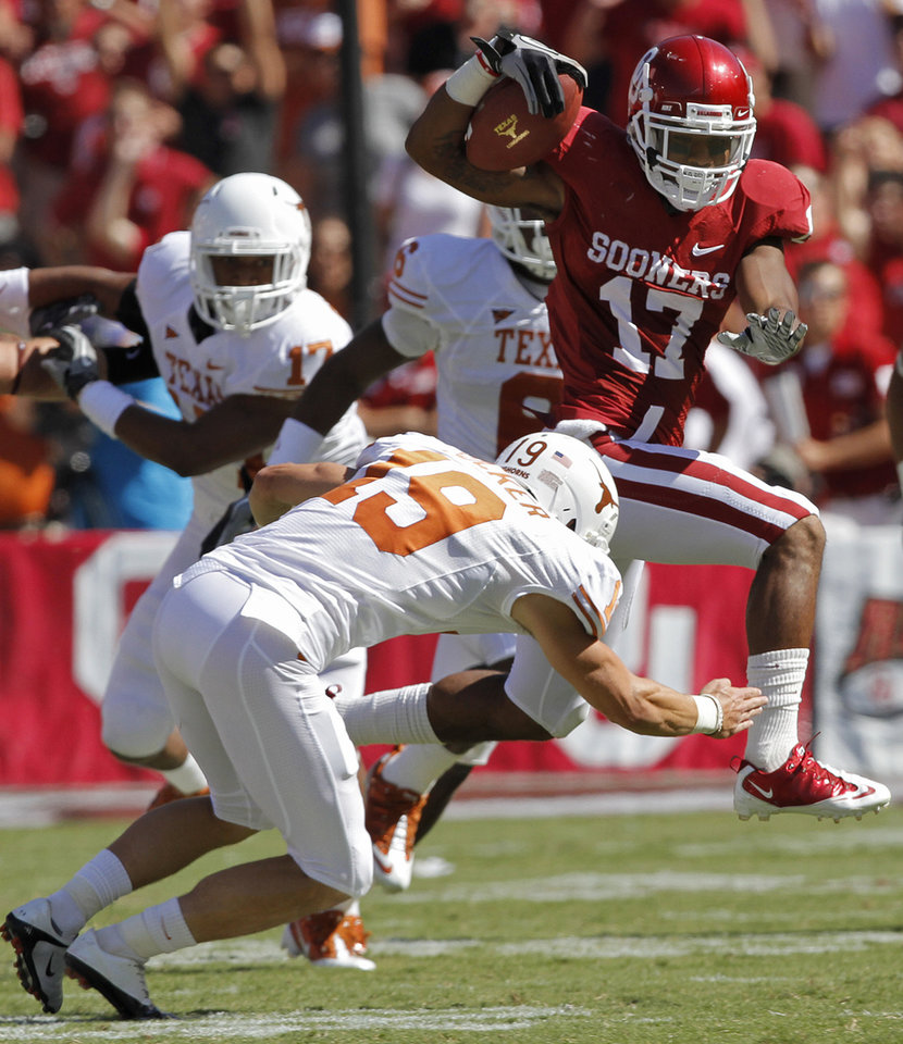 Oklahoma's Mossis Madu (17) tries to get past Texas kicker Justin Tucker (19) of the Red River Rivalry college football game between the University of Oklahoma Sooners (OU) and the University of Texas Longhorns (UT) at the Cotton Bowl on Saturday, Oct. 2, 2010, in Dallas, Texas.   Photo by Chris Landsberger, The Oklahoman