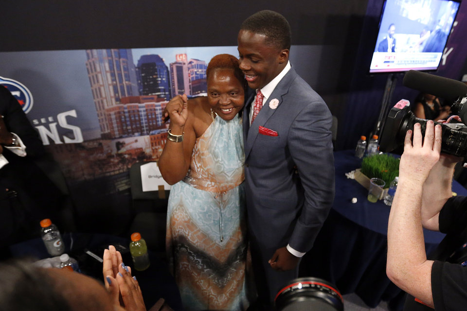 Photo - Teddy Bridgewater, from Louisville, embraces his mother Rose Murphy after being selected 32nd overall by the Minnesota Vikings in the first round of the NFL football draft, Thursday, May 8, 2014, at Radio City Music Hall in New York. (AP Photo/Jason DeCrow)