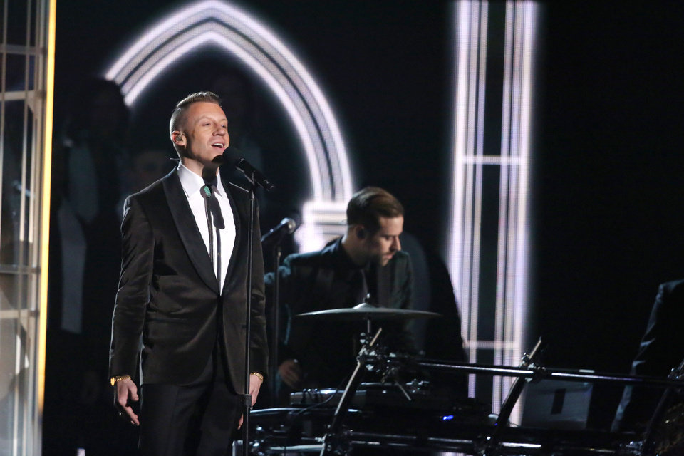 """Photo - Macklemore performs """"Same Love"""" on stage at the 56th annual Grammy Awards at Staples Center on Sunday, Jan. 26, 2014, in Los Angeles. (Photo by Matt Sayles/Invision/AP)"""