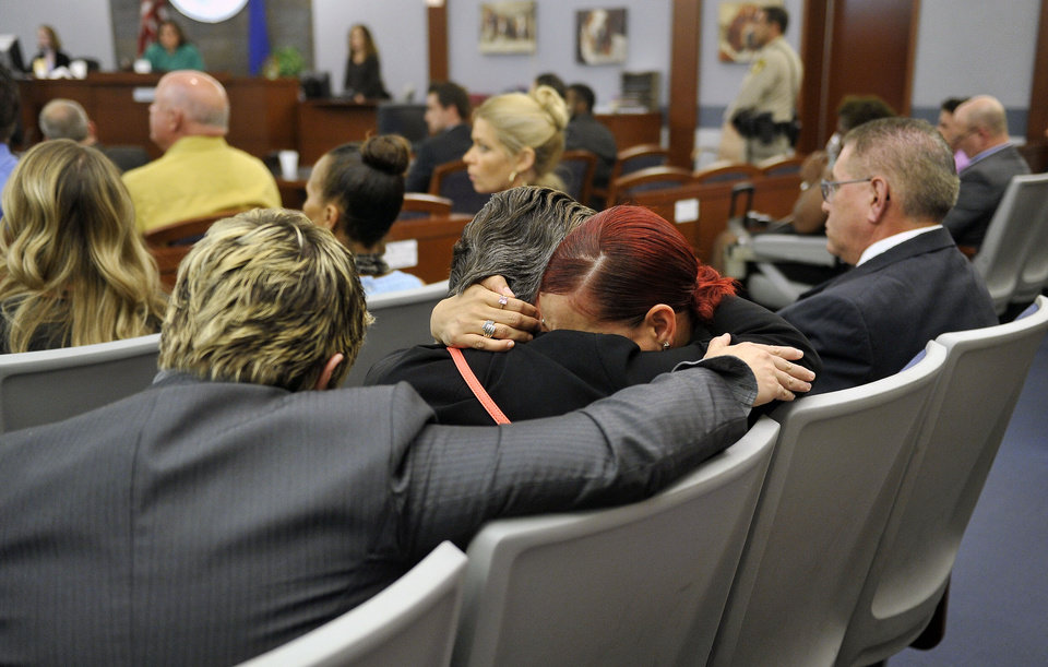 Photo - Celeste Flores Narvaez, second right, sister of Deborah Flores Narvaez, is comforted after a guilty verdict was read during a murder trial at the Regional Justice Center on Thursday, May 22, 2014. Jason Omar Griffith was convicted of second degree murder of his girlfriend and Luxor